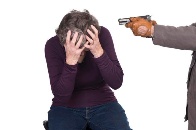 elderly woman under attack by knife or gun