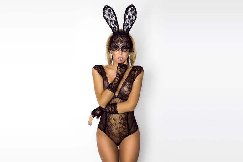 Beautiful, blonde woman in elegant lingerie and black lace Easter bunny mask. Body, animal.