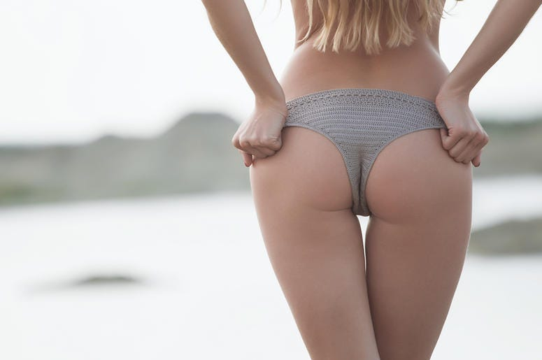 close up outdoor shot of young woman& x27;s back. Adult, hips.