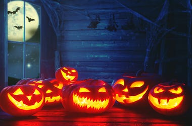 Spooky halloween background. scary pumpkin with burning eyes