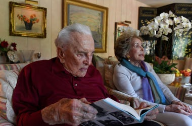 Beverly Hills, CA: Kirk Douglas looks over a copy of a new book he and wife and Anne have written 'Kirk and Anne.' Kirk, 100 and Anne, 97, have a written the book