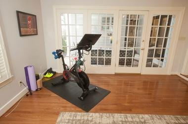 The home office of Jahna Lindsay-Jones contains a Peleton exercise bike. The office doors behind the bike lead to the home's patio. 25 March 2019 Richard and Jahna Lindsay-Jones' Louisville home