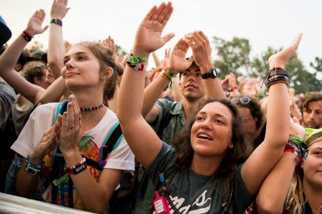 The crowd cheers as Moon Taxi performs at the Bonnaroo Music and Arts Festival.