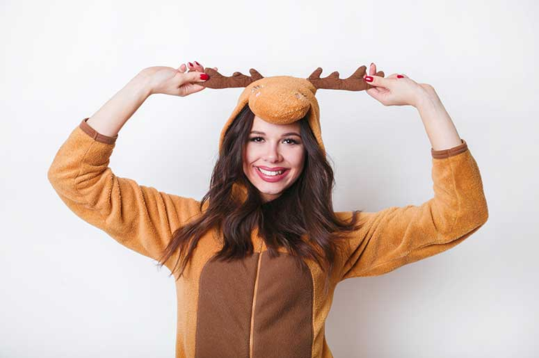 woman wearing deer onesie pajamas