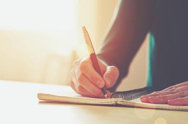 Writing with a pen.