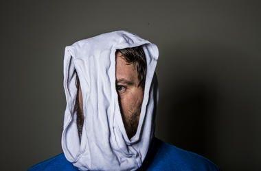 man wearing underwear on his head