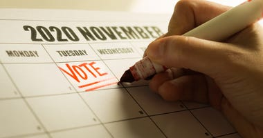 USA Presidential vote reminder written on a 2020 November calendar
