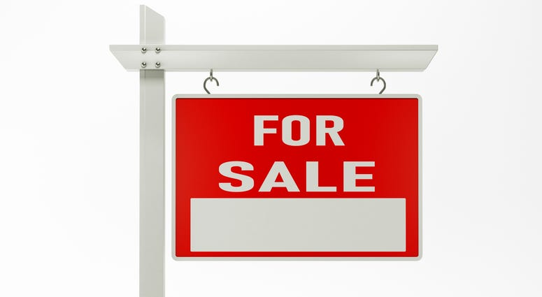 Real estate signage for sale on white