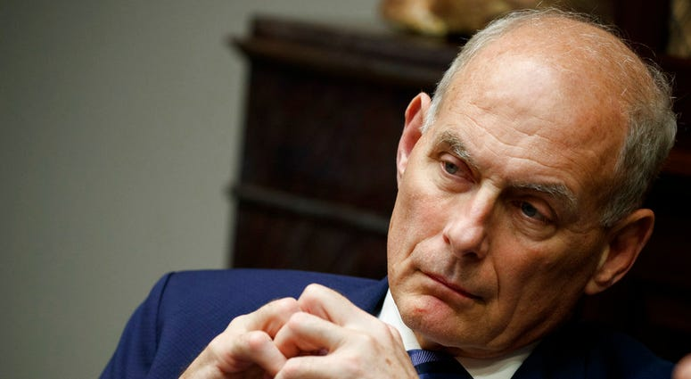 In this June 21, 2018 photo, White House chief of staff John Kelly listens as President Donald Trump speaks during a lunch with governors in the Roosevelt Room of the White House in Washington. Trump says chief of staff John Kelly will leave his job at th