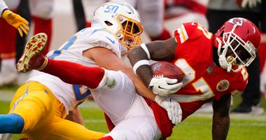Kansas City Chiefs' Rashad Fenton is tackled by Los Angeles Chargers linebacker Cole Christiansen, left, during the first half of an NFL football game, Sunday, Jan. 3, 2021, in Kansas City.