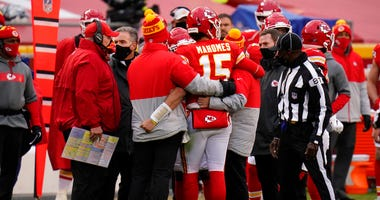 Kansas City Chiefs quarterback Patrick Mahomes (15) is helped off the field after getting injured during the second half of an NFL divisional round football game against the Cleveland Browns, Sunday, Jan. 17, 2021, in Kansas City.