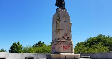 Defaced state of Christopher Columbus in Chicago's Grant Park.