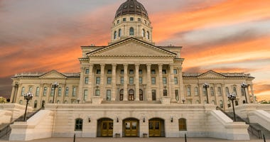 Kansas governor turns to pensions for budget breathing room