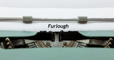 Old fashioned typewriter and paper - with typing that reads 'Furlough'