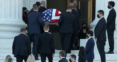 Mourners pay respects to Justice Ginsburg at the Supreme Court