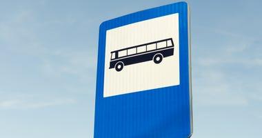Bus station road sign on blue sky