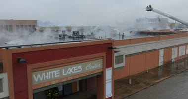 Fire crews fight blaze from roof of White Lakes Mall in Topeka.