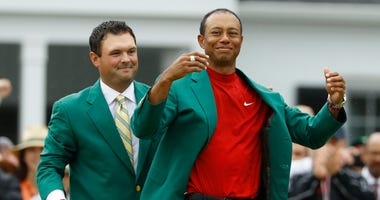 Woods ready to play Masters and realizes it has to wait