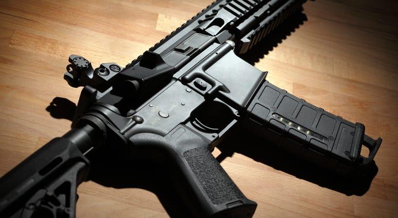 Modern custom AR-15 carbine on a wooden surface