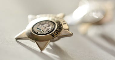 Golden star police badge