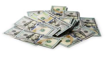 Bundle of US 100 dollars bank notes isolated on white background