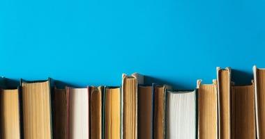 Books on blue background