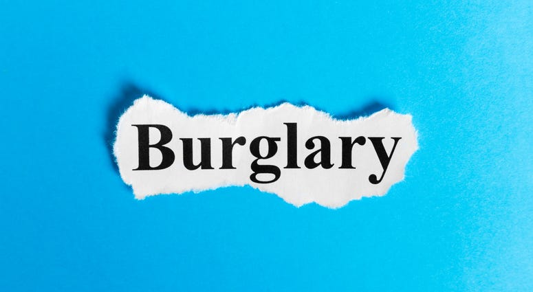 the word burglary on a blue background