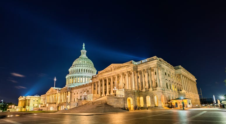 The United States Capitol Building at night in Washington, D.C.