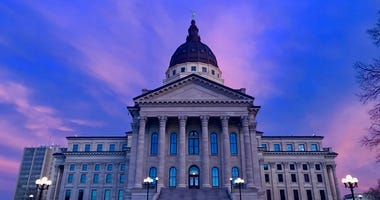 Kansas State Capitol building during a colorful sunset
