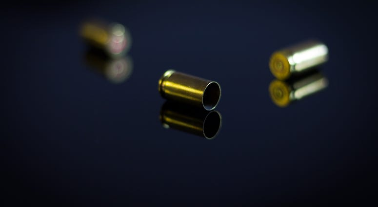 Casings of bullets on a glass table