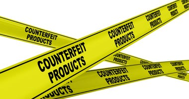 Yellow warning tapes with black text COUNTERFEIT PRODUCTS