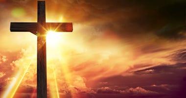 Large wooden crucifix at sunrise