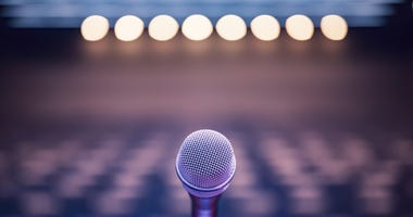 Microphone over a blurred background.