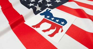 Series of USA ruffled flags with democratic party symbol over it
