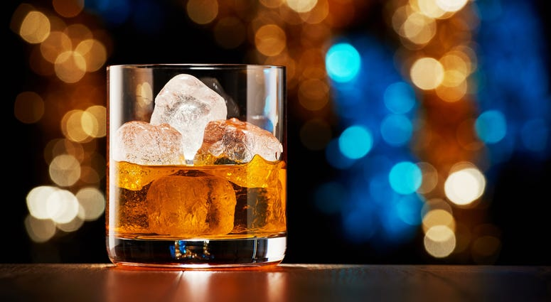 Glass of whiskey with ice