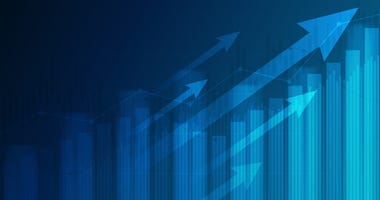 Financial graph with uptrend line and arrows in stock market on blue color background