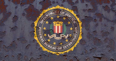 Flag of the Federal Bureau of Investigation on a rusty background