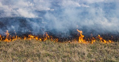 Grass fire burning in a field