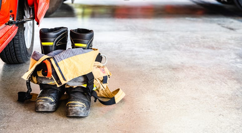 Flame retardant fireman's boots and pants ready to be used in case of emergency