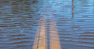 High water flooding with roadway underneath