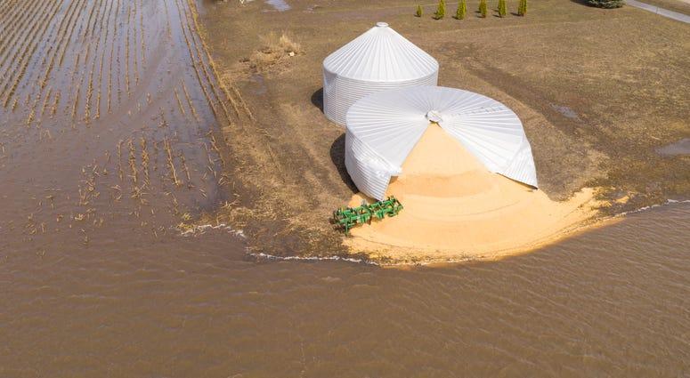 Iowa farm silo burst by Midwest flooding March 2019