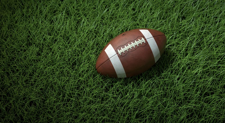 A close-up of a football on the field
