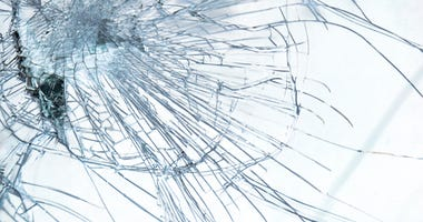 Close up detail of a broken windshield in a car accident