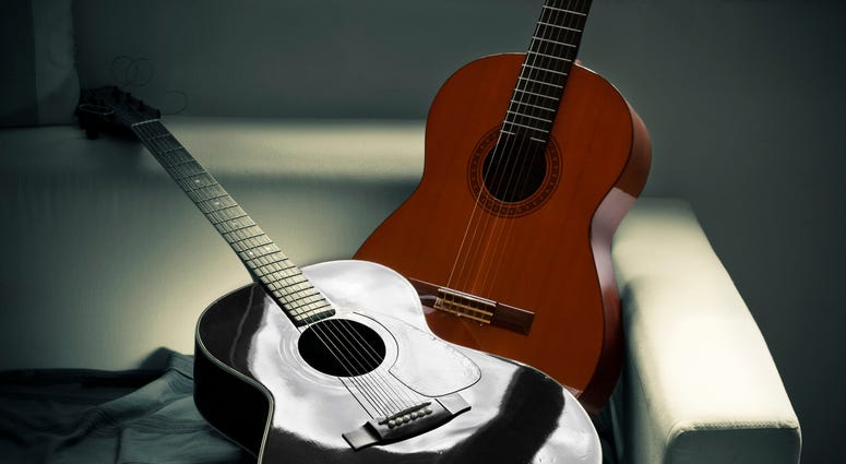 Picture of two acoustic guitars