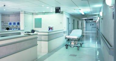 Hospital hallway with gurney