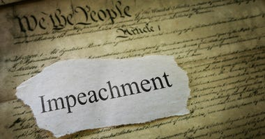 Illustration of the constitution with the word impeachment on it