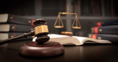 Judge gavel and scale in court