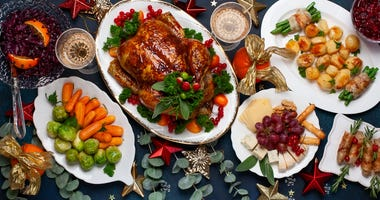 Christmas dinner with roasted chicken and various vegetables dishes