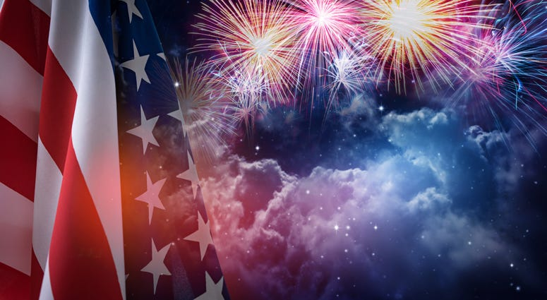 American flag and fireworks with night sky background
