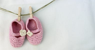 Knitted pink baby sandals